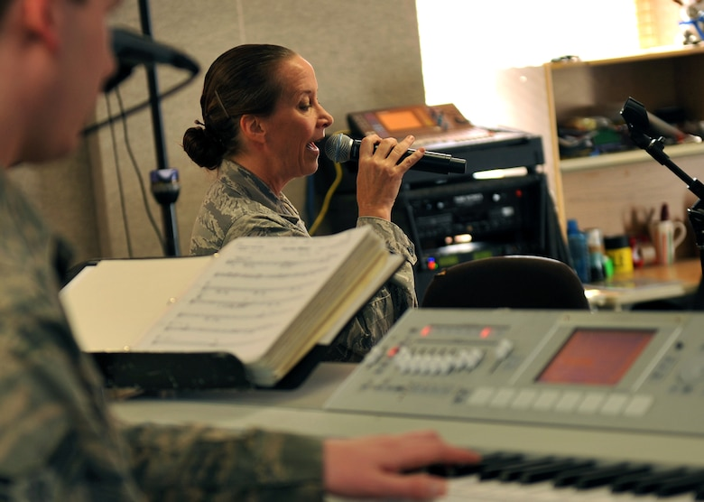 U.S. Air Force Tech. Sgt. Rebecca Packard, USAF Heartland of America Band vocalist, rehearses for an upcoming performance.  Packard is also the band's First Sergeant. (U.S. Air Force photo by Jeff W. Gates/Released)