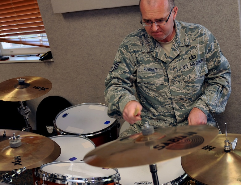 U.S. Air Force Tech. Sgt. Jarrett Robinett, USAF Heartland of America Band drummer rehearses for an upcoming performance. Band members are responsible for practicing individually and as a group.  (U.S. Air Force photo by Jeff W. Gates/Released)