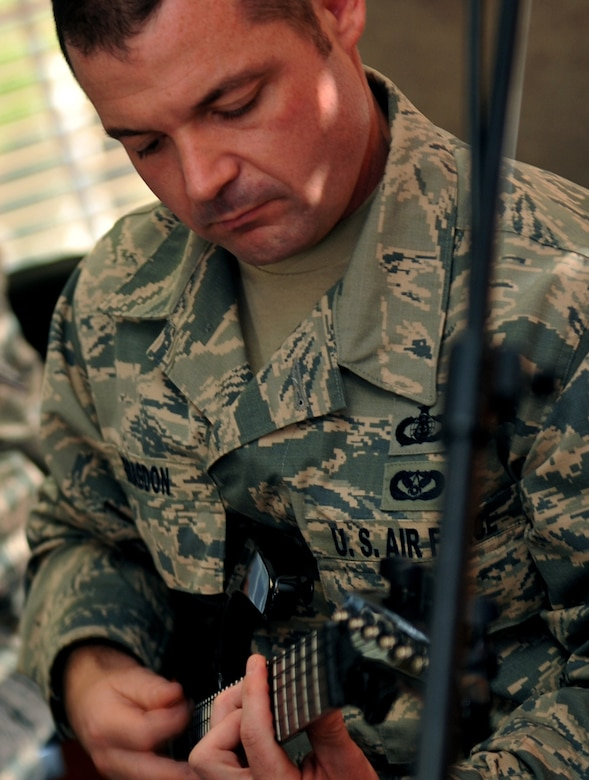 U.S. Air Force Tech. Sgt. Daniel Bragdon, USAF Heartland of America Band guitarist, rehearses for an upcoming performance.  Members of the band not only play their respective instruments, but are also responsible for several additional duties. (U.S. Air Force photo by Jeff W. Gates/Released)