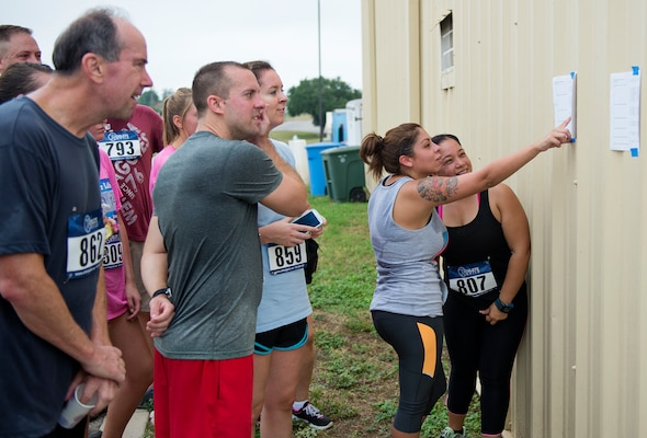Participants of the 5k Run for Life check their run times.(U.S. Air Force photo by Benjamin Faske/Released)