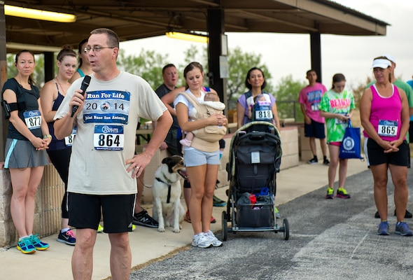 Col. John Andrus, 59th Medical Operations Group commander, delivers opening remarks at the 5k Run for life. (U.S. Air Force photo by Benjamin Faske/Released)