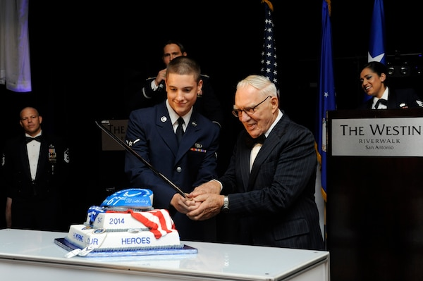 Airman Elijah Grenier, 502nd Communications Squadron, and retired Lt. Col. Ramon Horinek, former Vietnam War prisoner of war, cut the cake during the Joint Base San Antonio celebration of the Air Force's 67th birthday Saturday at the Westin Hotel in San Antonio.