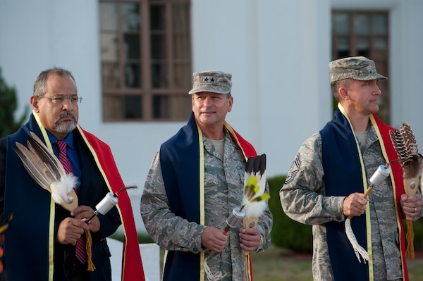Fil Jimenez, 502nd Air Base Wing technical director, Maj. Gen. Leonard Patrick, vice commander for Air Education and Training Command, and  Chief Master Sgt. Jimmie Morris, 340th Flying Training Group command chief, accept a fan and rattle during the  Joint Base San Antonio-Randolph State of Texas American Indian Heritage Day gourd dance and reveille event Sept. 26. American Indian Heritage Day in Texas, signed into law in 2013, recognizes historical, cultural and social contributions of American Indian communities and leaders of Texas. (U.S. Air Force photo/Desiree N. Palacios)