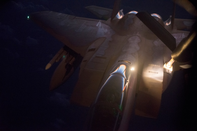 A U.S. Air Force F-15C Eagle refuels from a 909th Air Refueling Squadron KC-135 Stratotanker over the ocean late at night Sept. 16, 2014. Sept. 29, 2014, marks the 35th anniversary of the F-15C's arrival to Kadena. At Kadena alone, the F-15C/D squadrons, the 67th, 44th and formerly 12th Fighter Squadrons, have earned the title of best Air Force fighter squadron of the year and the prestigious Raytheon Trophy, formerly the Hughes Trophy, nine times since the aircraft's arrival 35 years ago. (U.S. Air Force photo by Senior Airman Maeson L. Elleman/Released)