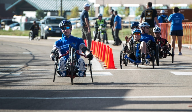 Former Senior Airman Jeremiah Means crosses the finish line at the Warrior Games cycling event Sept. 29, 2014, at Fort Carson, Colo. Means competed in the hand-cycling heat taking eighth place in his category. (U.S.  Air Force photo/Senior Airman Jette Carr)