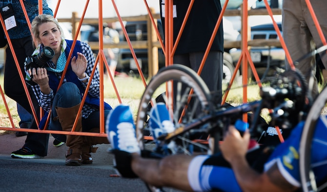 Ashley Means watches for her husband Jeremiah at the finish line of the Warrior Games cycling event Sept. 29, 2014, at Fort Carson, Colo. Ashley serves a s a caretaker for Jeremiah, a former Senior Airman and wounded warrior. (U.S.  Air Force photo/Senior Airman Jette Carr)