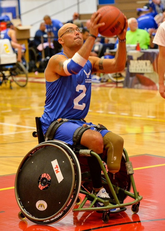 Master Sgt. Christopher Aguilera warms up before his game against the Navy in the first wheelchair basketball game of the 2014 Warrior Games Sept. 29, 2014, at the United States Olympic Training Center in Colorado Springs, Colo. The Air Force team lost 38-19 and will play Special Operations in the next round. (U.S Air Force photo/Staff Sgt. Devon Suits)