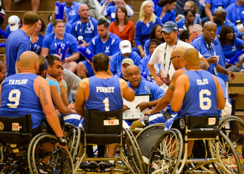 Coach Willie Jackson goes over the next play during an Air Force time out in their game against the Navy at the 2014 Warrior Games Sept. 29, 2014, at the United States Olympic Training Center in Colorado Springs, Colo. The Air Force team lost 38-19 and will play Special Operations in the next round. (U.S Air Force photo/Staff Sgt. Devon Suits)