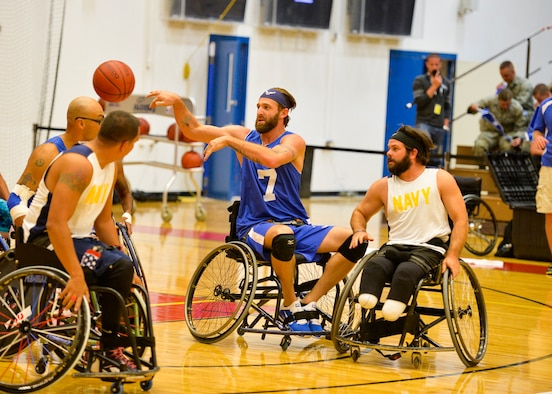 Retired Senior Airman Ryan Gallo makes a pass during the Air Force wheelchair basketball game against the Navy at the 2014 Warrior Games Sept. 29, 2014, at the United States Olympic Training Center in Colorado Springs, Colo. The Air Force team lost 38-19 and will play Special Operations in the next round. (U.S Air Force photo/Staff Sgt. Devon Suits)