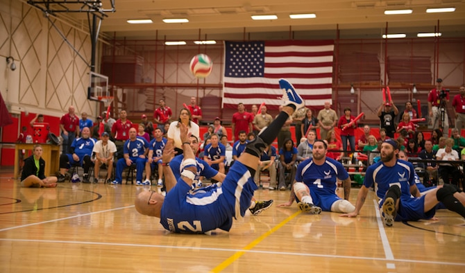 Air Force volleyball team player Christopher Aguilera returns a serve from the Marine Corps team to his teammates at the Warrior Games Sept. 29, 2014, in Colorado Springs, Colo. The Airmen gave the Marines a run for their money as both teams had to struggle for every point. (U.S. Marine Corps photo/Cpl. Cuong Le)