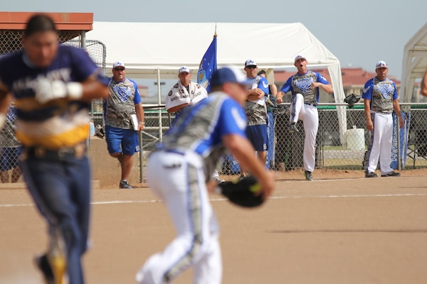 Air Force celebrates a close play at first at the 2014 Armed Forces Softball Championship at Fort Sill, Okla. 14-19 September.
