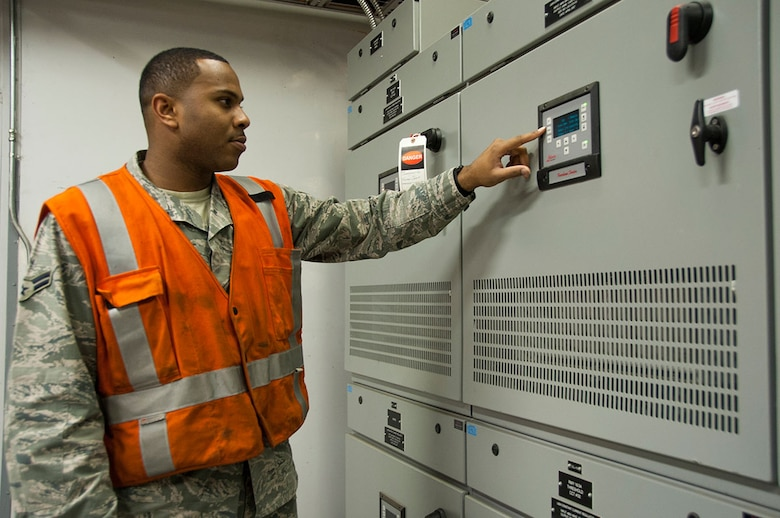 Airman 1st Class Ethen Price, 773d Civil Engineer Squadron electrical systems journeyman, checks the voltage output from an enclosed high-voltage cable system on Joint Base Elmendorf-Richardson, Alaska, Sept. 22, 2014. To provide a safer work environment, the exposed 4,160 high voltage wiring has been replaced with an enclosed regulator system where the electricians can safely walk inside the vault. (U.S Air Force photo/Airman 1st Class Tammie Ramsouer)