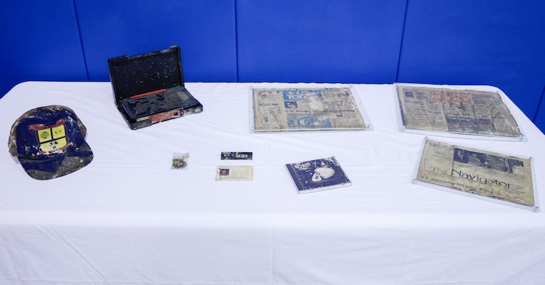 Sailors at the Naval Nuclear Power Training Command on Joint Base Charleston, S.C. retrieved a Time Capsule, Sept. 22, 2014, and displayed the contents during a ceremony in honor of the opening of the Bowman Center Multi-Purpose Room on the NNPTC Campus. Though slightly weathered, the contents, which were buried in 1989, were preserved well enough for today's student's to enjoy a blast from the past. (U.S. Navy photo/Petty Officer 3rd Class Gabriel Villareal)