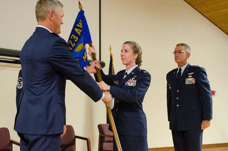 Col. Kathryn Pfeifer, former director of staff for Headquarters, Kentucky Air National Guard, assumes command of the 123rd Mission Support Group as she accepts the unit's guidon from Col. Barry Gorter, commander of the 123rd Airlift Wing, during a change-of-command ceremony held at the Kentucky Air National Guard Base in Louisville, Ky., Aug 9, 2014. Pfeifer replaces Lt. Col. Matthew Stone (right), who is the new director of staff at Headquarters, Kentucky Air National Guard. (U.S. Air National Guard photo by Senior Airman Joshua Horton)