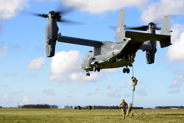 Members of the 321st Special Tactics Squadron fast rope out of a CV-22B Osprey assigned to the 7th Special Operations Squadron March 25, 2015, at RAF Sculthorpe in Norfolk, England. The Special Tactics Air Commandos regularly train on how to infiltrate a potentially hostile area – through Fast Rope Insertion Extraction System or high-altitude, low-opening entries. (U.S. Air Force photo by Tech. Sgt. Stacia Zachary)