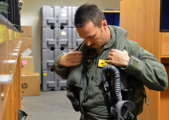 Maj. Joshua Arki prepares to fly the F-35A Lightning II 1,000th training sortie March 31, 2015, at Luke Air Force Base, Ariz. Arki is a pilot with the 61st Fighter Squadron which is part of the 56th Fighter Wing. The wing was the fastest F-35 wing to reach the 1,000-sortie milestone in the Defense Department. (U.S. Air Force photo/Senior Airman Devante Williams)