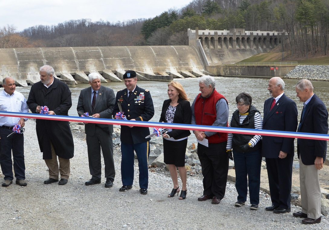 With the Dam Safety Assurance Program work to reduce risk at Dover Dam officially complete, the Huntington District, U.S. Army Corps of Engineers hosted a ribbon cutting ceremony at Dover Dam to mark the occasion.