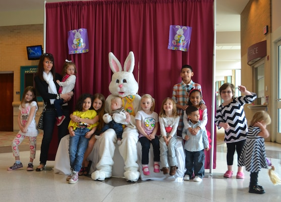 "Military families and friends joined the Michigan National Guard Family Programs staff and the Easter bunny for an egg hunt at the Lansing Center in downtown Lansing, Michigan, on Sunday, April 13, 2014. Secretary of Defense Caspar W. Weinberger in 1986 designated each April as ""The Month of the Military Child"" as a way to recognize contributions that the military child makes as their parent or parents serve our states and nation."