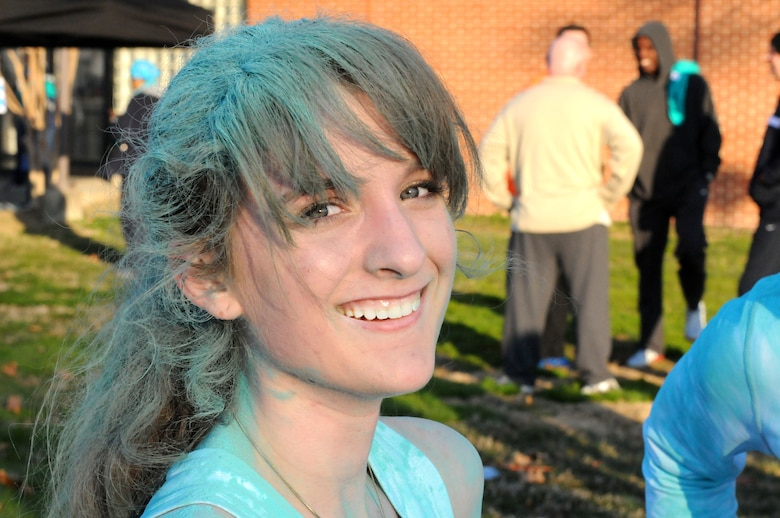 Airman 1st Class Kourtney Marah, 113th Wing, D.C. Air National Guard, shows off the shiny teal color in her hair after running in the Joint Base Andrews Sexual Assault Awareness and Prevention Month 5K Color run Apr. 1, 2015.  Marah supported the event to raise awareness of sexual assault in the military and help eliminate it once and for all.  (Air National Guard photo by Master Sgt. Craig Clapper)