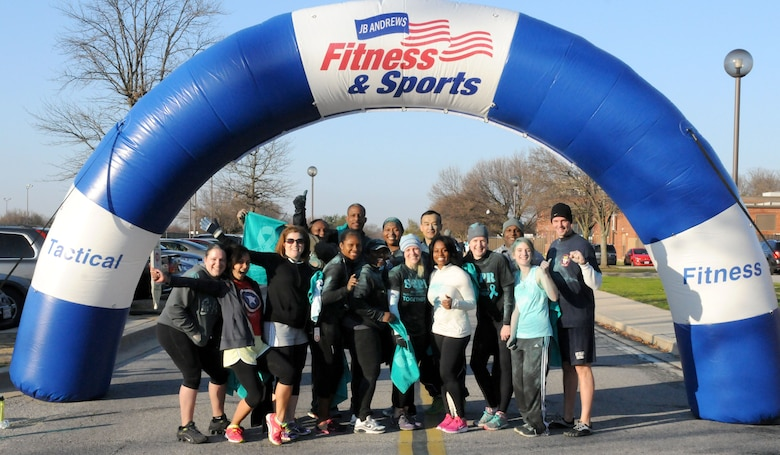 """D.C. Air National Guard members stand at the finish line after running in the Joint Base Andrews Sexual Assault Awareness and Prevention Month 5K Color run Apr. 1, 2015.  The DCANG """"Capital Guardians"""" supported the event to raise awareness of sexual assault in the military and help eliminate it once and for all.  (Air National Guard photo by Master Sgt. Craig Clapper)"""