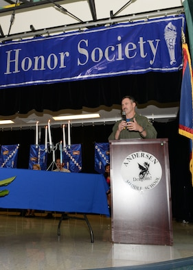 Brig. Gen. Andrew Toth, 36th Wing commander, speaks to Team Andersen students during the Andersen Middle School National Junior Honor Society induction ceremony March 27, 2015, at Andersen Air Force Base, Guam. Toth and his wife, Cheryl, presented students with pins and cords as they were awarded membership to the NJHS. (U.S. Air Force photo by Senior Airman Amanda Morris/Released)