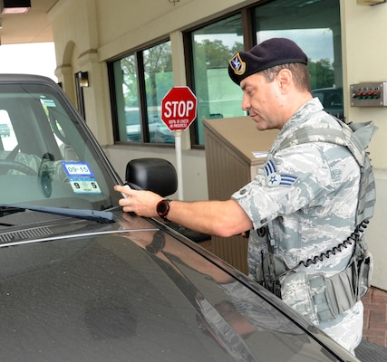 Senior Airman Fredric Bantin, 902nd Security Forces Squadron entry controller, checks a