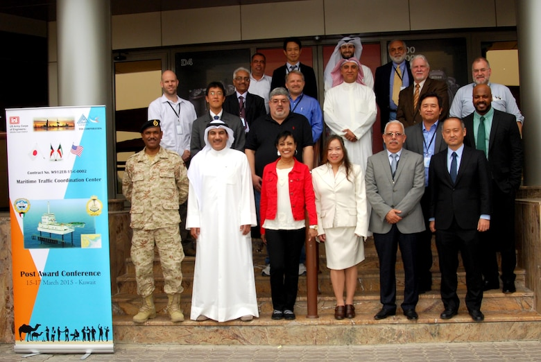 Participants in a partnering meeting take a moment to pose for a group photo March 17.