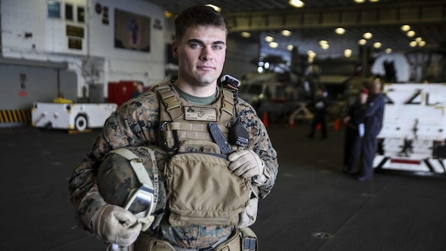 U.S. Marine Corps Cpl. Jeremiah Skaggs poses in the hangar bay of the USS Bonhomme Richard, at sea, March 16, 2015. Skaggs, from Stockton, California, has trained in multiple environments including Bridgeport, California, Twentynine Palms, California, Okinawa, Japan, and now aboard the USS Bonhomme Richard. Skaggs is a squad leader with Weapons Co., Battalion Landing Team 2nd Battalion, 4th Marine Regiment, 31st Marine Expeditionary Unit and is currently participating in the MEU's annually-scheduled Spring Patrol of the Asia-Pacific region.