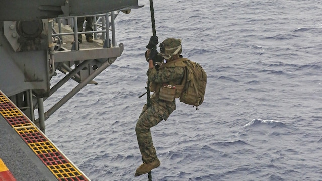 A U.S. Marine fast-ropes out of an MV-22B Osprey during an exercise on the flight deck of the USS Bonhomme Richard, at sea, Feb. 18, 2015. Each Marine had a chance to go down the rope multiple times. After fast-roping, the Marines practiced rappelling from the Osprey. The Marines are with Weapons Co., Battalion Landing Team 2nd Battalion, 4th Marine Regiment, 31st Marine Expeditionary Unit, and the Osprey is from Marine Medium Tiltrotor Squadron 262. The Marines are currently participating in the MEU's annually-scheduled Spring Patrol of the Asia-Pacific region.
