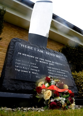 A wreath lies at the foot of the Wrath-11 memorial monument March 31, 2015, following a remembrance ceremony on RAF Mildenhall, England. The WRATH-11 memorial monument displays the names of the nine Airmen who perished when an MC-130H Combat Talon II assigned to the 7th Special Operations Squadron, crashed in Albania during a training exercise in 2005. (U.S. Air Force photo by Senior Airman Victoria H. Taylor)