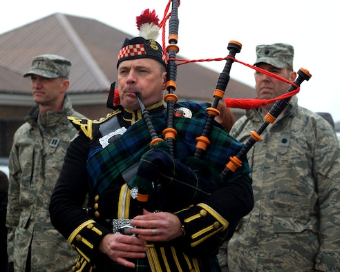Will Bissett, a bagpiper, plays during the remembrance ceremony March 31, 2015, at the 7th Special Operations Squadron on RAF Mildenhall, England. The ceremony, held in honor of the 10th anniversary of the nine Airmen who died when WRATH-11, an MC-130H Combat Talon II assigned to the 7th SOS, crashed in Albania on March 31, 2005. The flight was part of a training exercise with two other aircraft to train on low-level and low-light flying. Bissett has played for the 7th SOS since the time the unit was stationed at RAF Alconbury. (U.S. Air Force photo by Senior Airman Victoria H. Taylor)