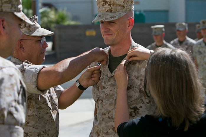 U.S. Marine Corps Master Sgt. Thomas Draffen is promoted to the rank of Master Gunnery Sergeant at Marine Corps Air Station Yuma, Ariz., April 1, 2015. Master Gunnery Sgt. Draffen was promoted by retired Master Gunnery Sgt. Michael Arnett, his drill instructor, after 20 years of faithful service. (U.S. Marine Corps photo by Cpl. Xzavior T. McNeal, MAWTS-1 COMCAM/Released)