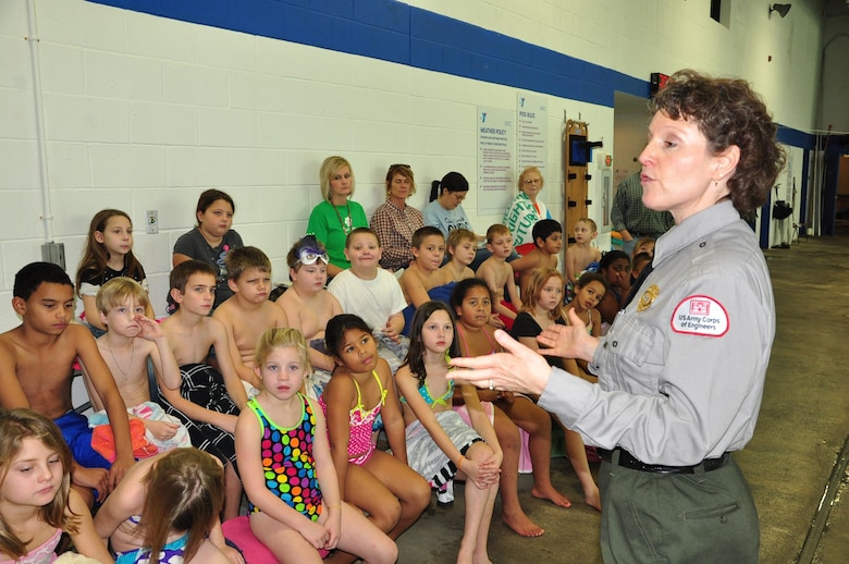 U.S. Army Corps of Engineers Park Ranger Sondra Carmen instructs youth today about lfe jackets and the importance of water safety as part of the Learn to Swim Program at the Putnam County Family YMCA in Cookeville, Tenn.