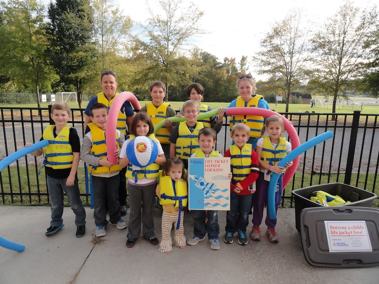 Students from the Putnam County School System wear BOAT US Foundation Life jackets to illustrate the importance of water safety in Cookeville, Tenn. The U.S. Army Corps of Engineers Nashville District park rangers and staff at Dale Hollow Lake are continuing to help keep kids and adults safe while recreating at area lakes and on the water by participating in the Boat US Foundation Life Jacket Loaner Program for kids! (USACE Photo by Sondra Carmen)