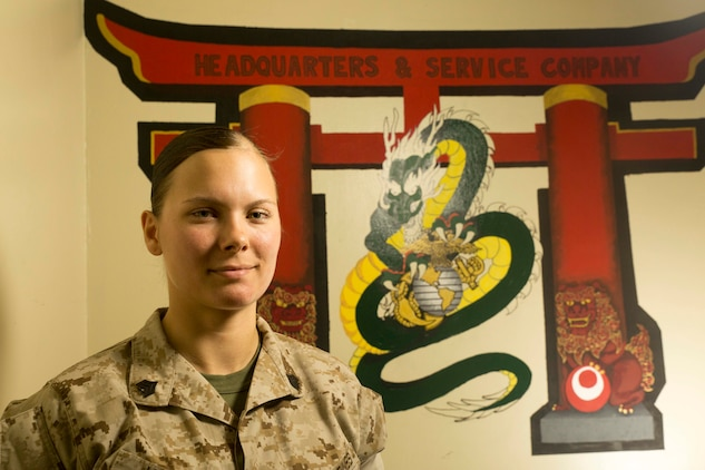 Sgt. Shelly Janecke, a self-made artist from Eaton Rapids, Michigan, redesigns the Headquarters and Service Company logo March 26 at Camp Courtney. She shows her passion of art through drawing, painting and designing tattoos. Janecke is the III Marine Expeditionary Force G-4 Materials Readiness Branch ammunition noncommissioned officer in charge with III MEF Headquarters Group, III MEF.