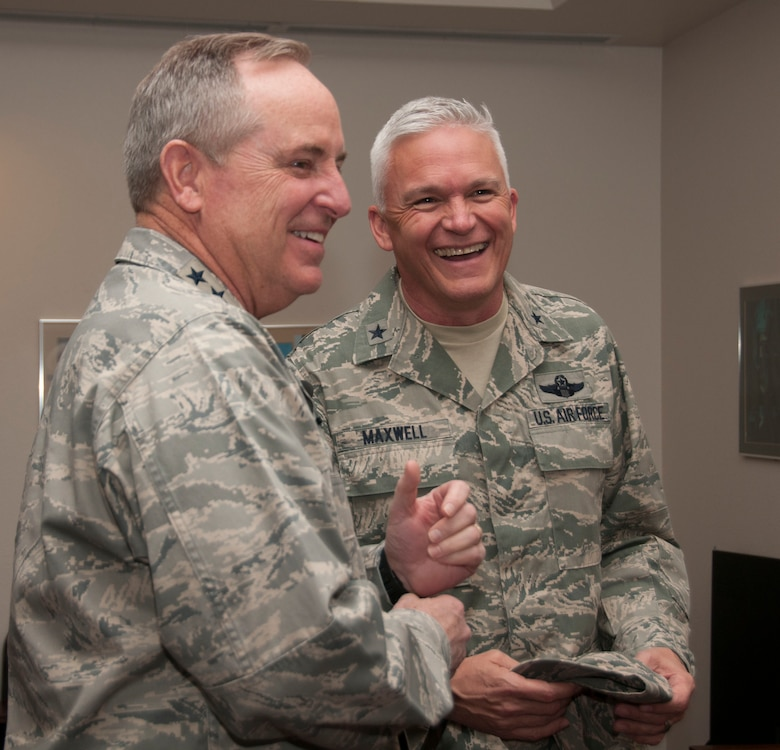 Air Force Chief of Staff Gen. Mark A. Welsh III visits with Gen. Edward  P. Maxwell, the Commander of the Arizona Air National Guard, during Welsh's  visit to the 162nd Wing, Tucson International Airport Air National Guard Base,  Arizona, on March 26. (U.S. Air National Guard photo by Staff Sgt. Gregory  Ferreira)
