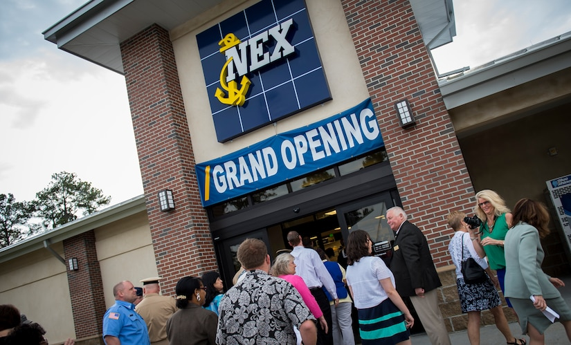 Members of Joint Base Charleston enter the newly opened student Naval Exchange April 1, 2015, on Naval Weapons Station Charleston, S.C. Students attending the Naval Nuclear Power Training Command school have very busy lives. By building the student NEX next to the NNPTC campus, it is much more convenient for students carrying heavy course loads to shop for needed items.  The student NEX is also located nearby other establishments focused on the students' needs.  (U.S. Air Force photo/Airman 1st Class Clayton Cupit)