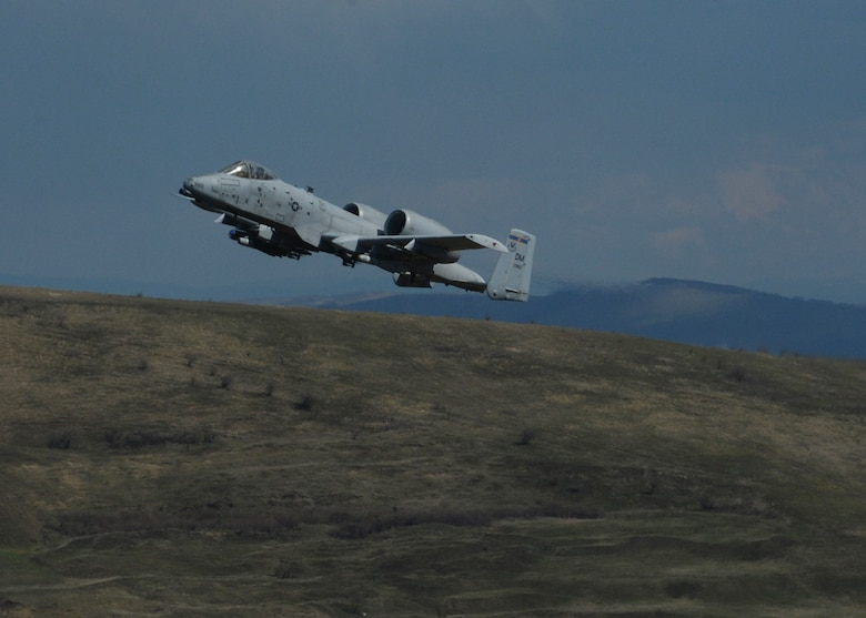 A U.S. Air Force A-10 Thunderbolt II assigned to the 354th Expeditionary Fighter Squadron flies during a theater security package deployment at Campia Turzii, Romania, April 1, 2015. The aircraft will forward deploy to locations in Eastern European NATO countries as part of the TSP. (U.S. Air Force photo by Staff Sgt. Joe W. McFadden/Released)