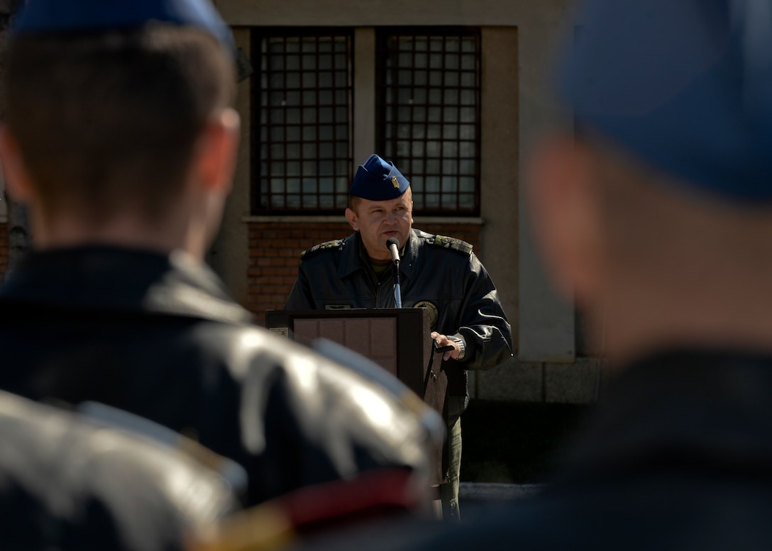 Romanian air force Cmdr. Marius Oatu, commander of the 71st Air Base, speaks during the opening ceremony of Dacian Thunder 2015 at Campia Turzii, Romania, April 1, 2015. The U.S. and Romanian air forces will conduct training aimed to strengthen interoperability and demonstrate the countries' shared commitment to the security and stability of Europe.  (U.S. Air Force photo by Staff Sgt. Joe W. McFadden/Released)