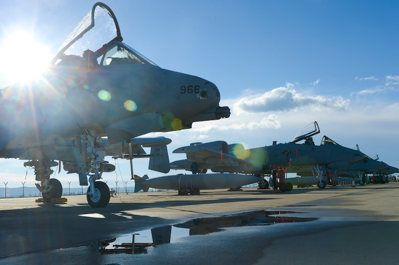 A row of U.S. Air Force A-10 Thunderbolt IIs assigned to the 354th Expeditionary Fighter Squadronare parked off the runway during a theater security package deployment at Campia Turzii, Romania, April 1, 2015.  The aircraft deployed to Romania in support of Operation Atlantic Resolve to bolster air power capabilities while underscoring the U.S. commitment to European security and stability. (U.S. Air Force photo by Staff Sgt. Joe W. McFadden/Released)