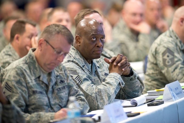 Command Chief Master Sgt. Lindsey McCall, command chief master sergeant of the 187th Fighter Wing, Alabama Air National Guard, listens to a presentation during the annual Command Chief's Huddle at Volk Field Combat Readiness Training Center, Wis., March 28, 2015. The Command Chief's Huddle brings together more than 150 Command Chief Master Sergeants and other senior enlisted leaders from 89 ANG wings and units, representing 54 states, territories and the District of Columbia, to openly discuss a wide range of issues and challenges facing the ANG. Attendees will also gain a better understanding of national issues relating to the ANG mission and share that knowledge with the 91,000 enlisted Air Guardsmen they represent. (U.S. Air National Guard photo by Master Sgt. Marvin R. Preston/Released)