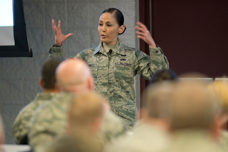 Tech. Sgt. Andrea Jamarillo, a Military Training Instructor assigned to the 323rd Training Squadron, Joint Base San Antonio-Lackland, Texas, addresses senior enlisted leaders during the annual Command Chief's Huddle at Volk Field Combat Readiness Training Center, Wis., March 28, 2015. The Command Chief's Huddle brings together more than 150 Command Chief Master Sergeants and other senior enlisted leaders from 89 ANG wings and units, representing 54 states, territories and the District of Columbia, to openly discuss a wide range of issues and challenges facing the ANG. Attendees will also gain a better understanding of national issues relating to the ANG mission and share that knowledge with the 91,000 enlisted Air Guardsmen they represent. (U.S. Air National Guard photo by Master Sgt. Marvin R. Preston/Released)