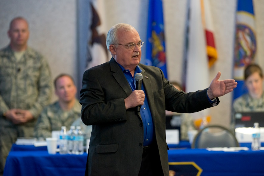 Retired Chief Master Sgt. Richard A. Smith, the ninth command chief master sergeant of the Air National Guard, addresses senior enlisted leaders during the annual Command Chief's Huddle at Volk Field Combat Readiness Training Center, Wis., March 28, 2015. The Command Chief's Huddle brings together more than 150 Command Chief Master Sergeants and other senior enlisted leaders from 89 ANG wings and units, representing 54 states, territories and the District of Columbia, to openly discuss a wide range of issues and challenges facing the ANG. Attendees will also gain a better understanding of national issues relating to the ANG mission and share that knowledge with the 91,000 enlisted Air Guardsmen they represent. (U.S. Air National Guard photo by Master Sgt. Marvin R. Preston/Released)