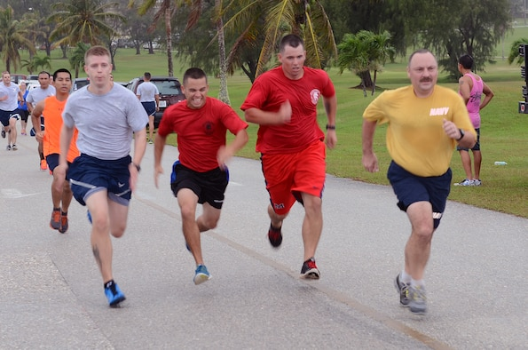 Runners compete to finish first during the April Fool's 5K at the Palm Tree Golf Course on Andersen Air Force Base, Guam, April 1, 2015. As an April Fool's Day joke, runners were told by event coordinators the course had been changed to a half marathon instead of a 5K. (U.S. Air Force photo by Airman 1st Class Alexa Ann Henderson/Released)
