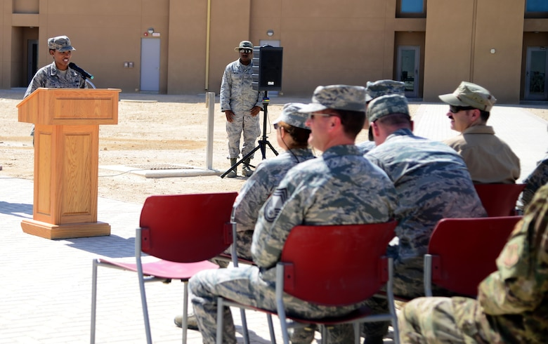 U.S. Air Force 1st Lt. Alisha Foster,  379th Expeditionary Force Support Squadron deputy sustainment flight commander, gives opening remarks during a linen cutting ceremony, April 3, 2015, at Al Udeid Air Base, Qatar. The linen cutting ceremony symbolized the opening of the new Phase II dormitories in the Blatchford-Preston Complex. (U.S. Air Force photo by Senior Airman Kia Atkins)