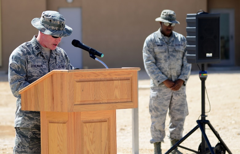U.S. Air Force Capt. John Boulware, 379th Air Expeditionary Wing chaplain, gives the invocation during a linen cutting ceremony, April 3, 2015, at Al Udeid Air Base, Qatar. The linen cutting ceremony symbolized the opening of the new Phase II dormitories in the Blatchford-Preston Complex. (U.S. Air Force photo by Senior Airman Kia Atkins)