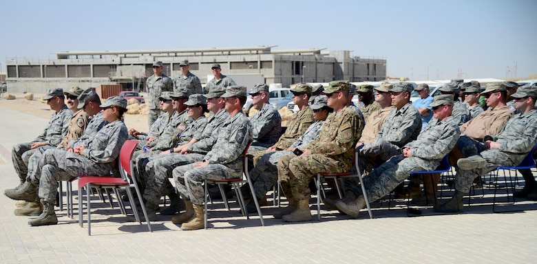 Attendees of the Blatchford-Preston Complex Phase II linen cutting ceremony listen to remarks before the grand opening of the new dormitories, April 3, 2015, at Al Udeid Air Base, Qatar. The opening of the BPC Phase II dormitories will make room for over 700 noncommissioned officers here at Al Udeid. (U.S. Air Force photo by Senior Airman Kia Atkins)
