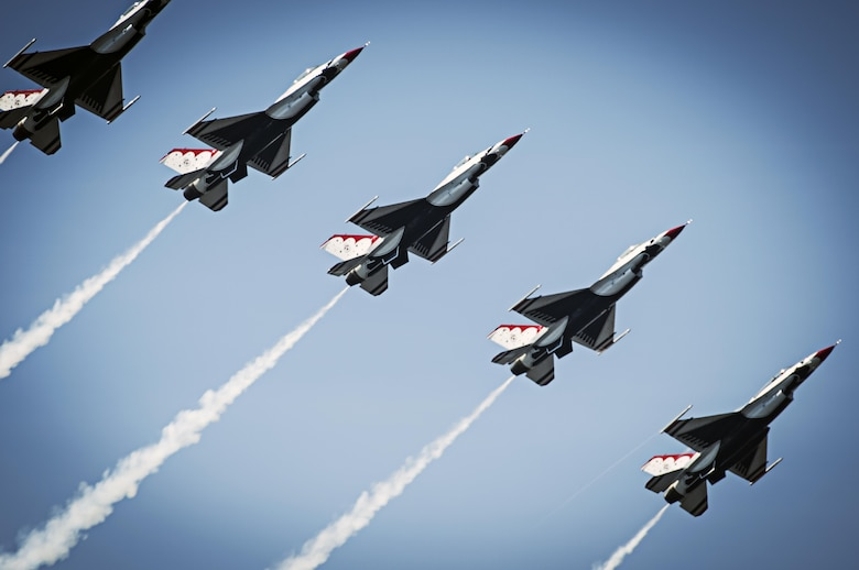The Thunderbirds pilots perform the Line Break Loop maneuver during the Thunder on the Bay Air Show, at Keesler Air Force Base, Miss., March, 28, 2015. (U.S. Air Force photo/Tech. Sgt. Manuel J. Martinez)