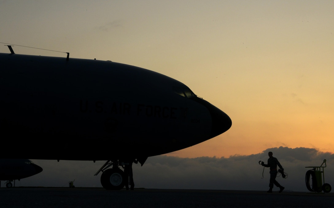 An Airman from the 909th Aircraft Maintenance Unit walks toward a KC-135 Stratotanker refueling aircraft during Exercise Forceful Tiger on Kadena Air Base, Japan, April 1, 2015. The Stratotankers allowed approximately 50 aircraft to stay airborne during the exercise for more than four hours.The KC-135 is assigned to the 909th Air Refueling Squadron. (U.S. Air Force photo/Staff Sgt. Maeson L. Elleman)