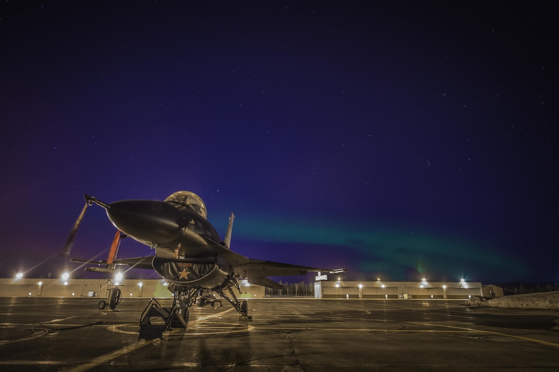 "An F-16 Fighting Falcon, from the 354th Fighter Wing, sits on the flightline on March 25, 2015, at Eielson Air Force Base, Alaska. The 354th FW mission is ""To prepare aviation forces for combat, deploy Airmen in support of global operations and enable the staging of forces."" (U.S. Air Force photo/Staff Sgt. Shawn Nickel)"